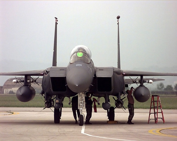 Members of the 494th Fighter Squadron RAF Lakenheath, UK perform post flight checks on an F-15E Strike Eagle on Wednesday, May 12, 1999. The F-15 is returning from an Operation Allied Force bombing mission over Yugoslavia. Members of the 494th are deployed to Aviano AB, Italy supporting NATO Operation Allied Force.    (USAF Photo, SrA Jeffrey Allen)