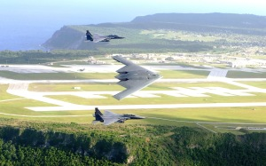 Two F-15E Strike Eagles Flank a B-2 Over Andersen AFB on Guam(USAF Photo, TSgt Cecilio Ricardo)